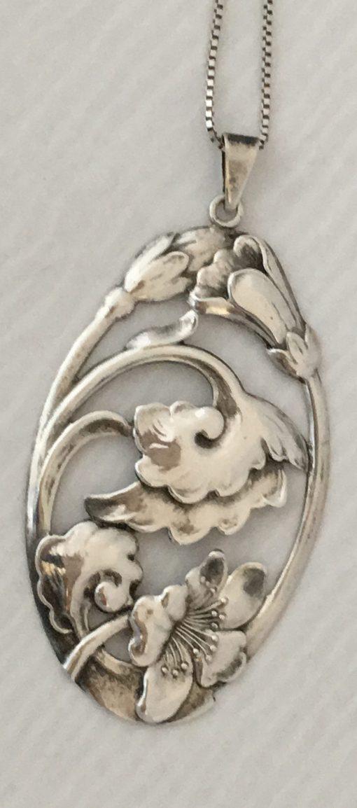 Danish oval foliate pendant